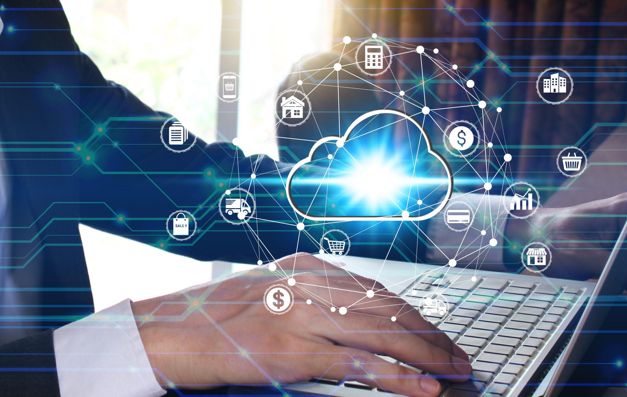 Businessman hand use laptop computer with virtual cloud computin